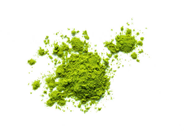 green matcha tea powder green matcha tea powder isolated on white background powder snow stock pictures, royalty-free photos & images