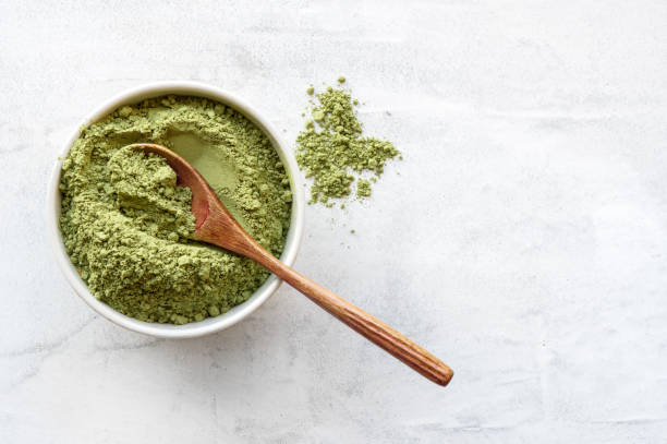 Green matcha tea powder. Top view. stock photo