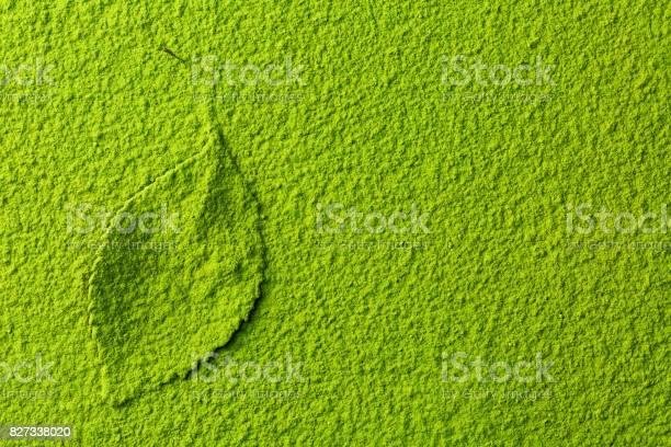 Photo of green matcha tea powder with tea leaf