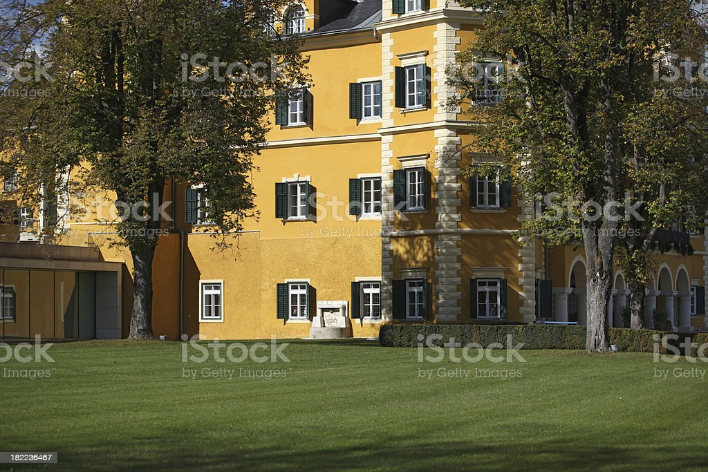 Green meadow and yellow romantic castle royalty-free stock photo
