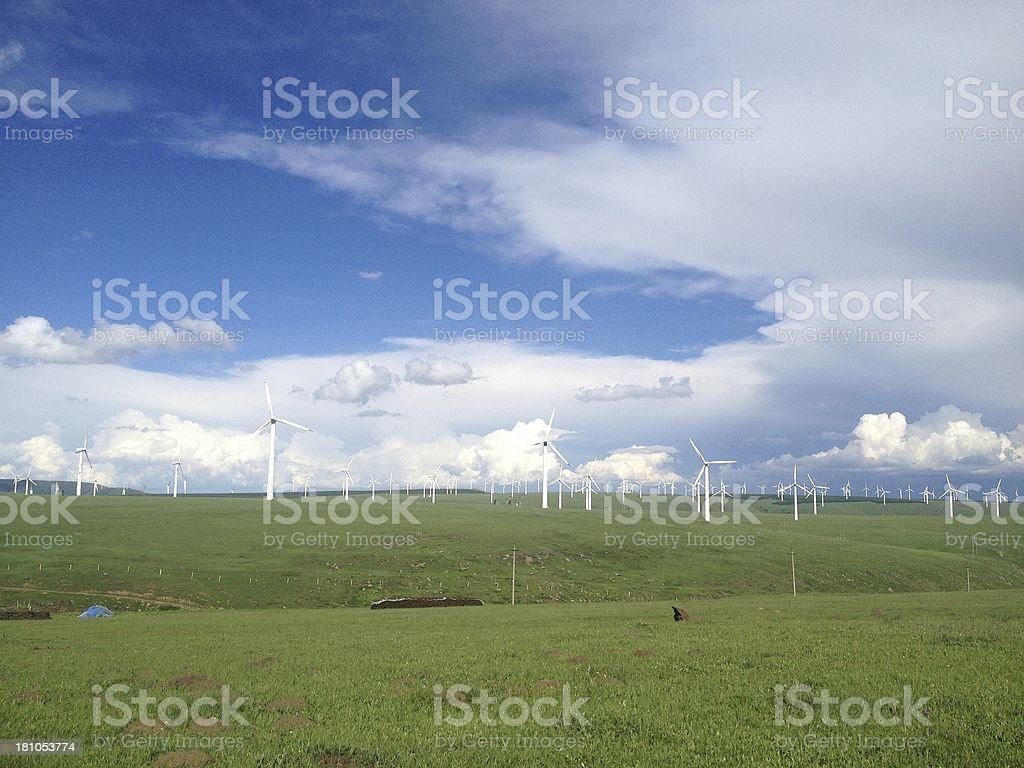 green meadow with Wind turbines generating electricity royalty-free stock photo