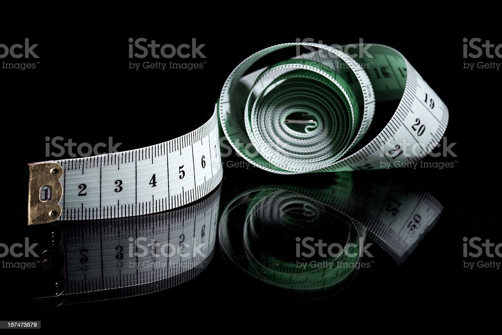 Green measuring tape royalty-free stock photo