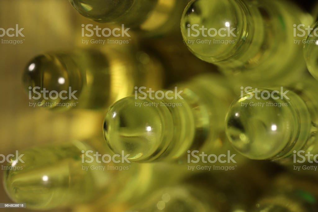 Green Medicine Ampoules. Pharmacy Background. Macro Closeup. royalty-free stock photo