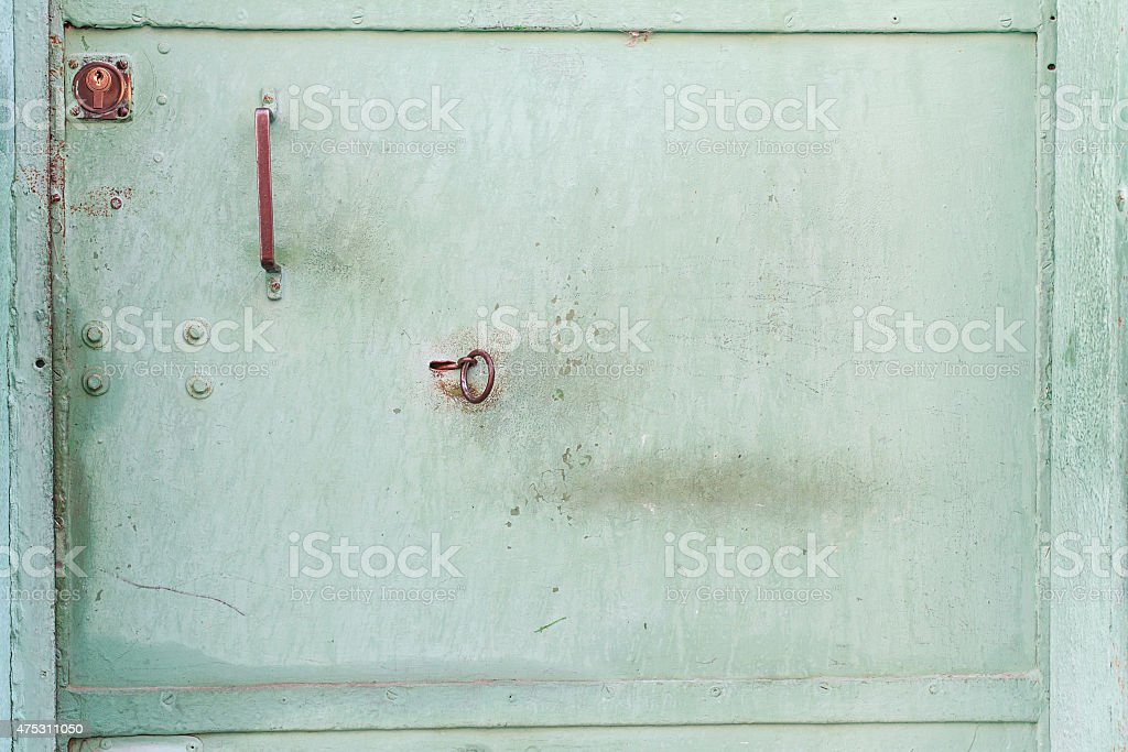 green metal door  texture with a keyhole. Vintage metal texture. stock photo