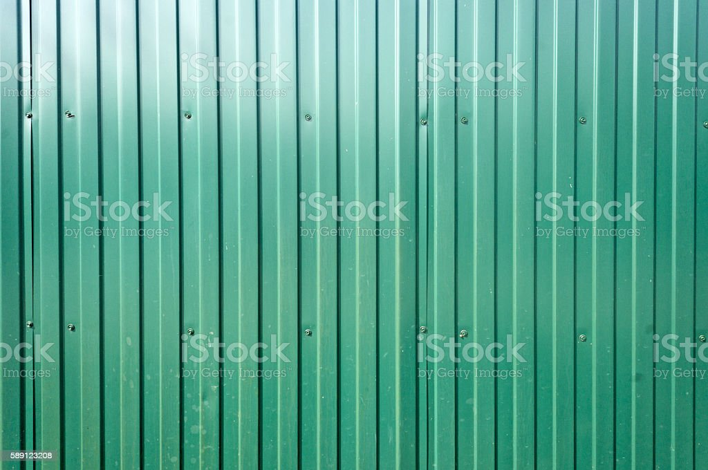 green metal fence background stock photo