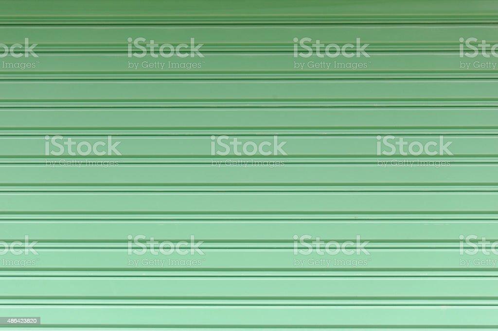 Green metal fence door stock photo