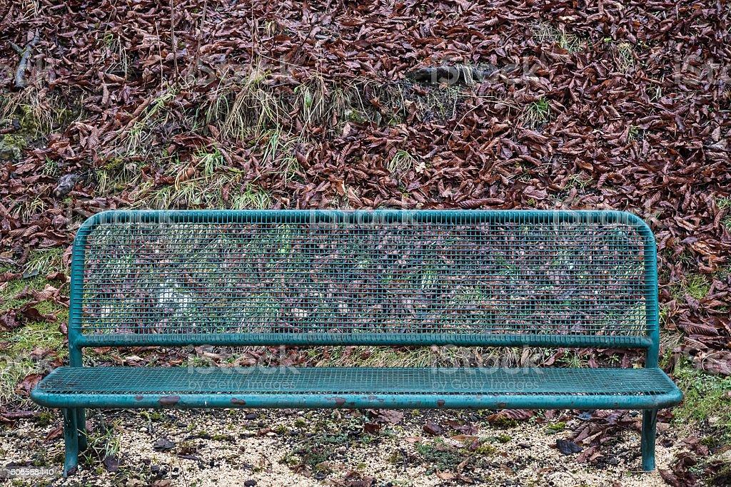 Green metal park bench stock photo
