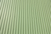 Green metal sheet siding of building