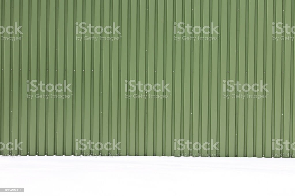 Green Metal Wall in Snow royalty-free stock photo