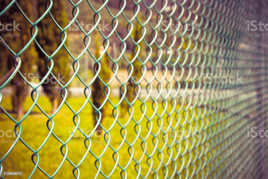 Green metal wire mesh - concept image stock photo