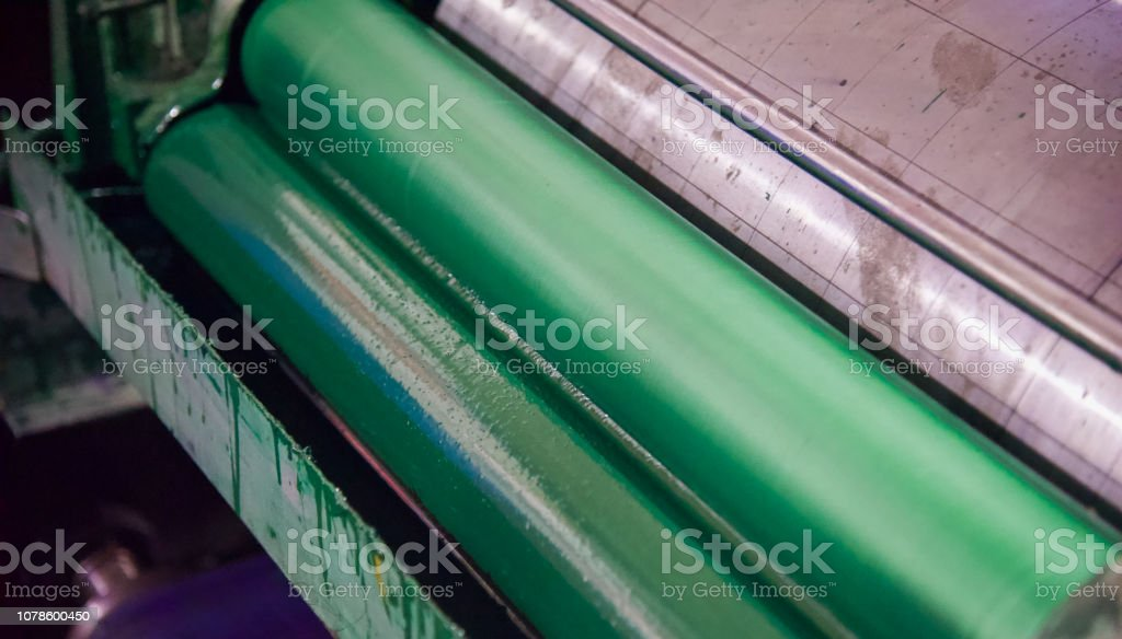 Green metallic colour roll of a printing machine stock photo