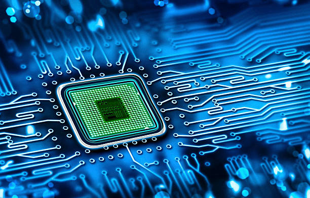 Green microchip set in a blue printed circuit board microchip integrated on motherboard computer chip stock pictures, royalty-free photos & images