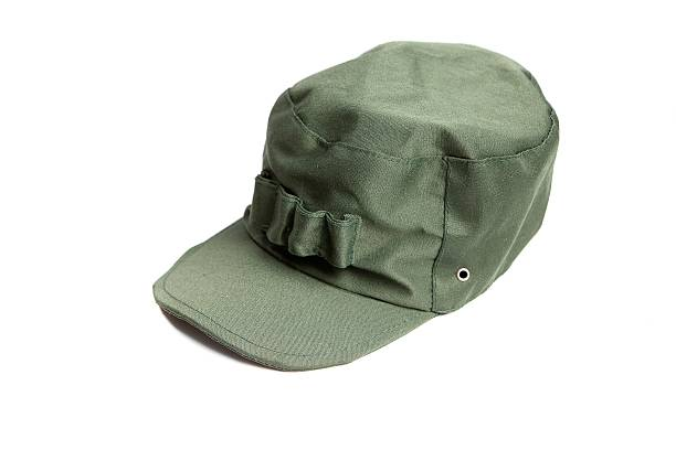 Green military cap Green military cap isolated on white background uniform cap stock pictures, royalty-free photos & images