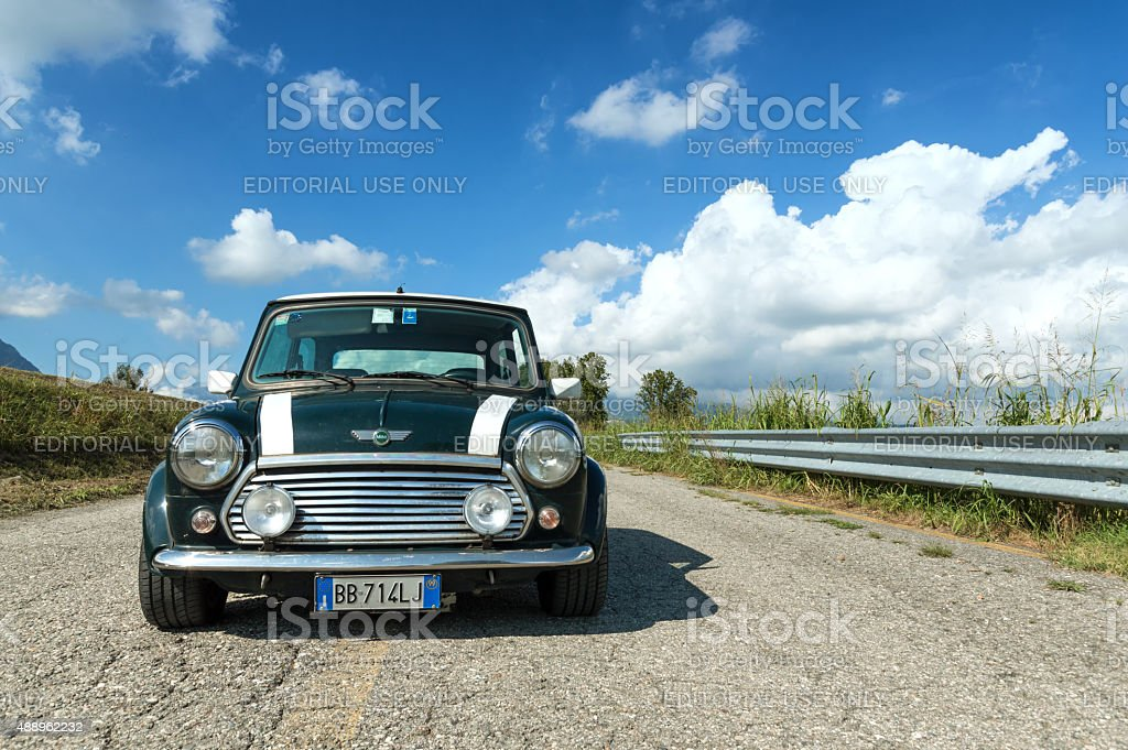 Green Mini Cooper with white stripes stock photo