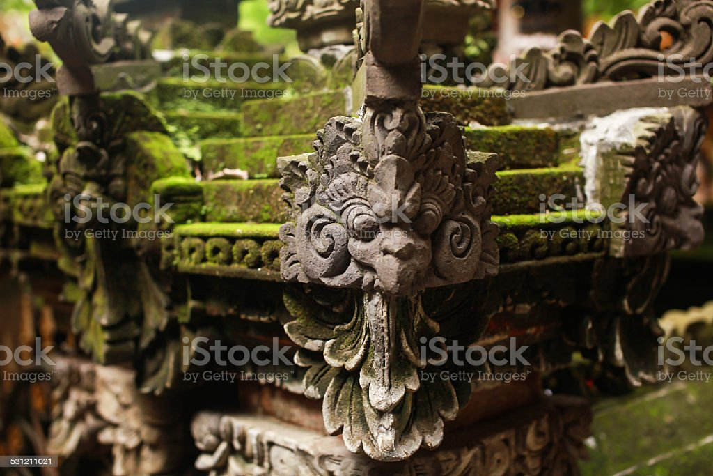 Green Moss and Garuda Statue stock photo
