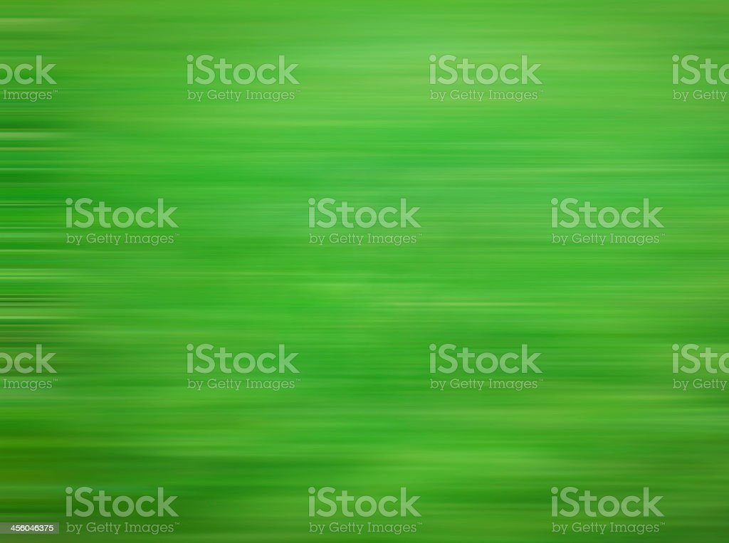 Green motion blurred abstract background stock photo
