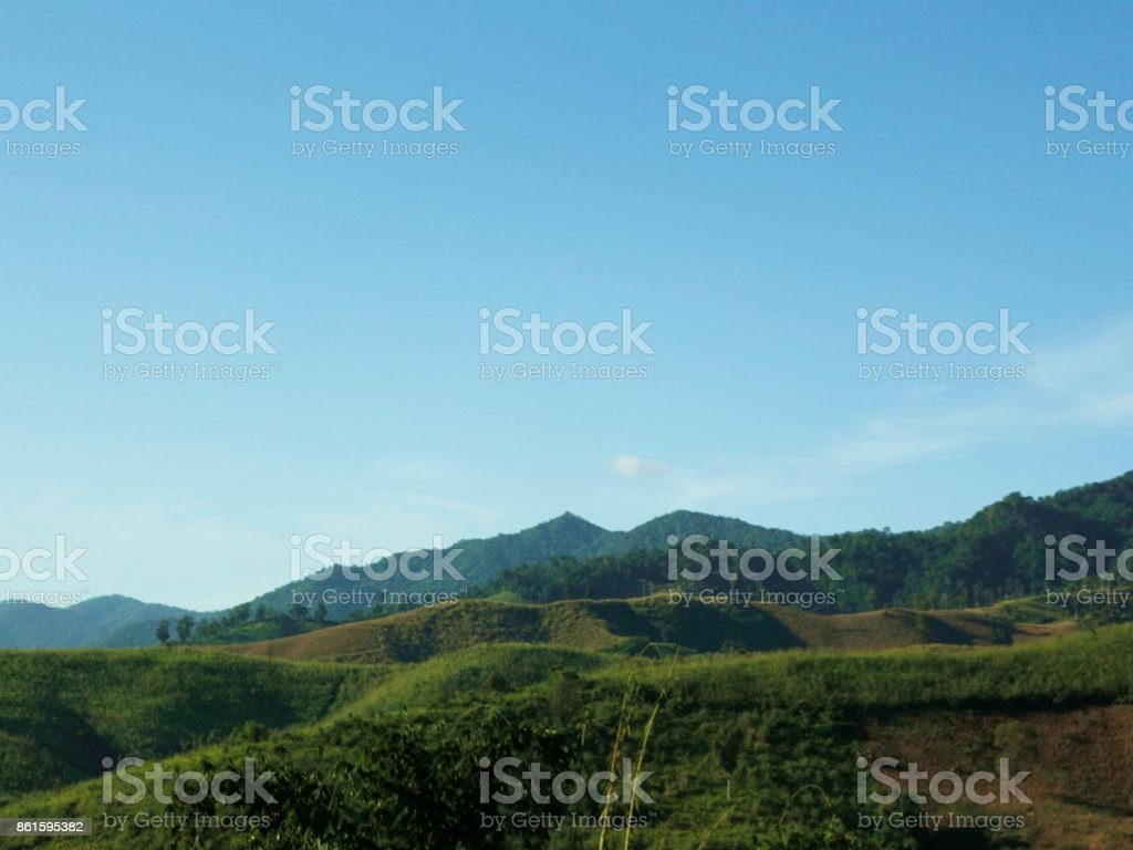 green mountain and blue sky stock photo