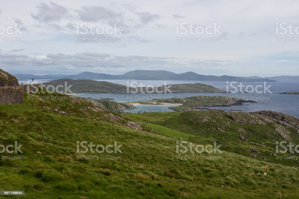 Green mountain and sandy cove stock photo