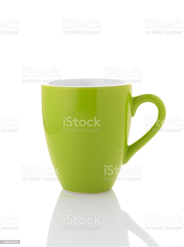 A green mug on a white background with the shadow in front stock photo