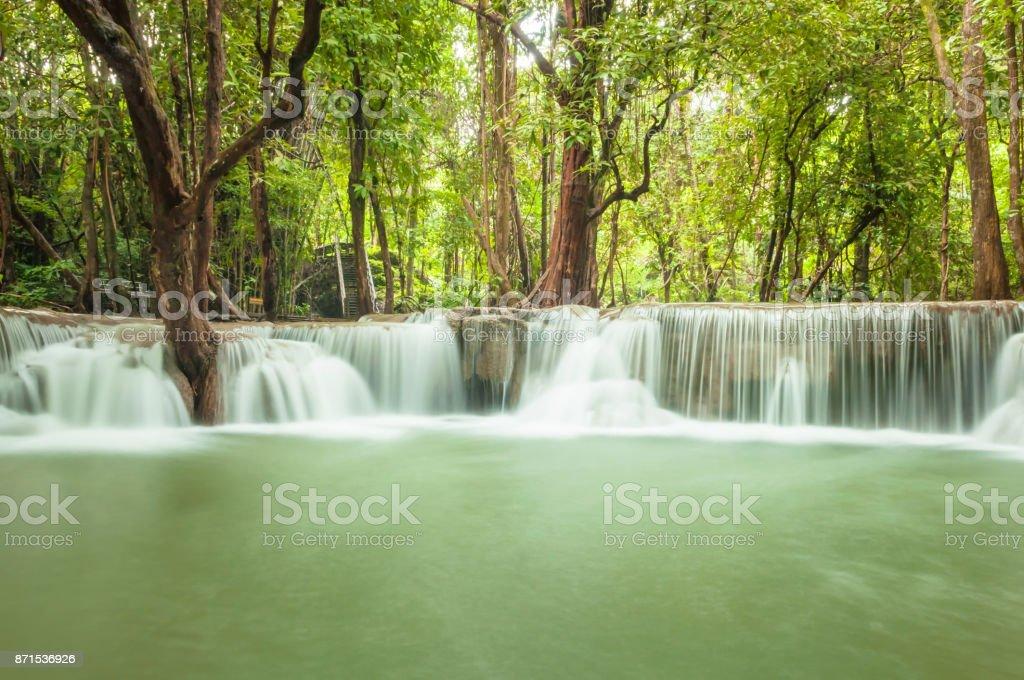 Green nature with green waterfall landscape, Erawan waterfall located Khanchanaburi Province, Thailand stock photo