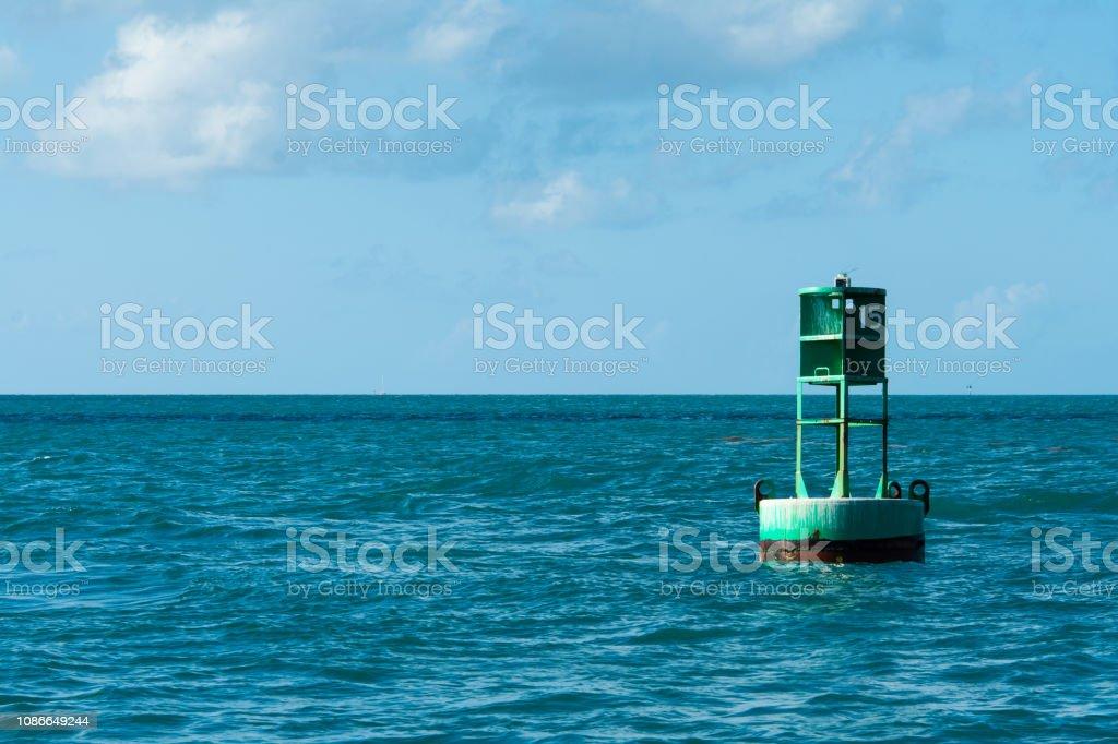 green navigation marker in key west harbor stock photo