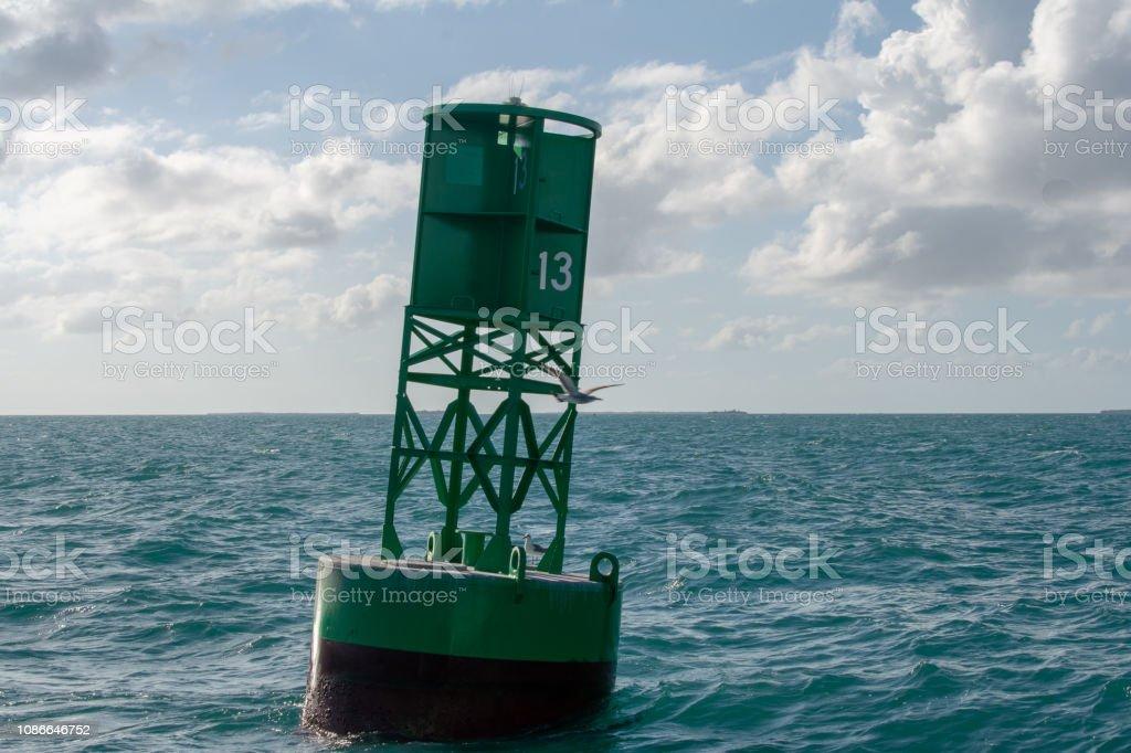 green navigational marker in key west harbor stock photo