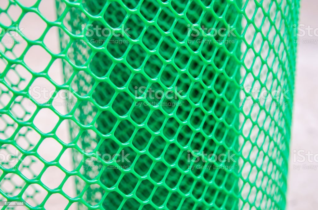 green net plastic, green extruded plastic mesh, green plastic fence net, bird netting stock photo
