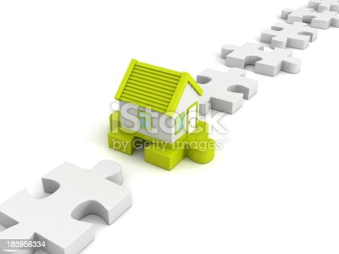 470163746 istock photo green new house on jigsaw puzzle in row 185956334