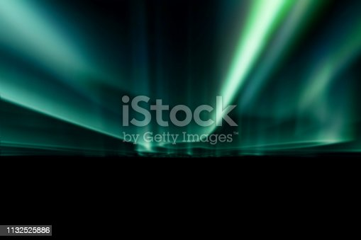 istock green northern lights against black back ground. 1132525886