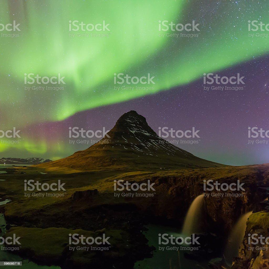 Green Northern lights over Kirkjufell volcano royalty-free stock photo