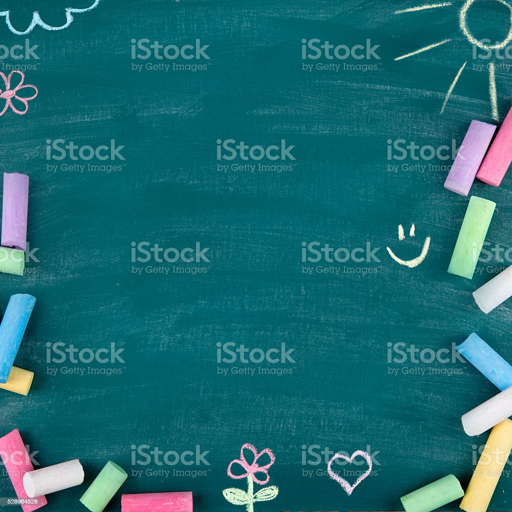 Green old empty chalkboard Green old empty chalkboard for copy space with colorful pieces of chalk Back to School Stock Photo