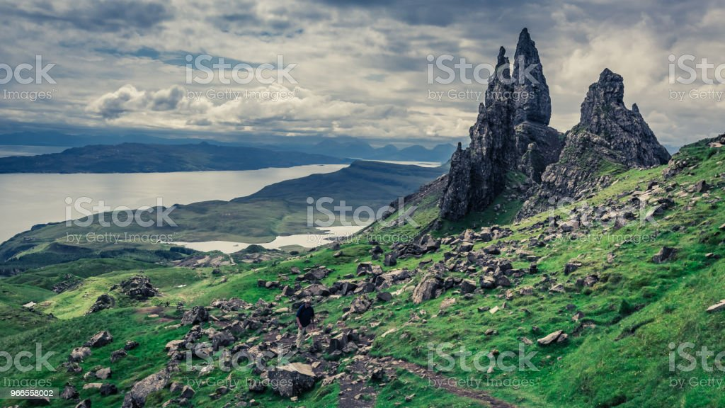 Green Old Man of Storr, Skye in cloudy day stock photo