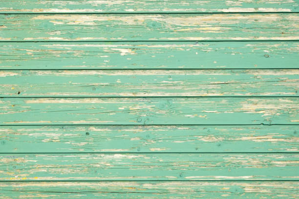 Green old weatherd wooden panels with textured green paint stock photo