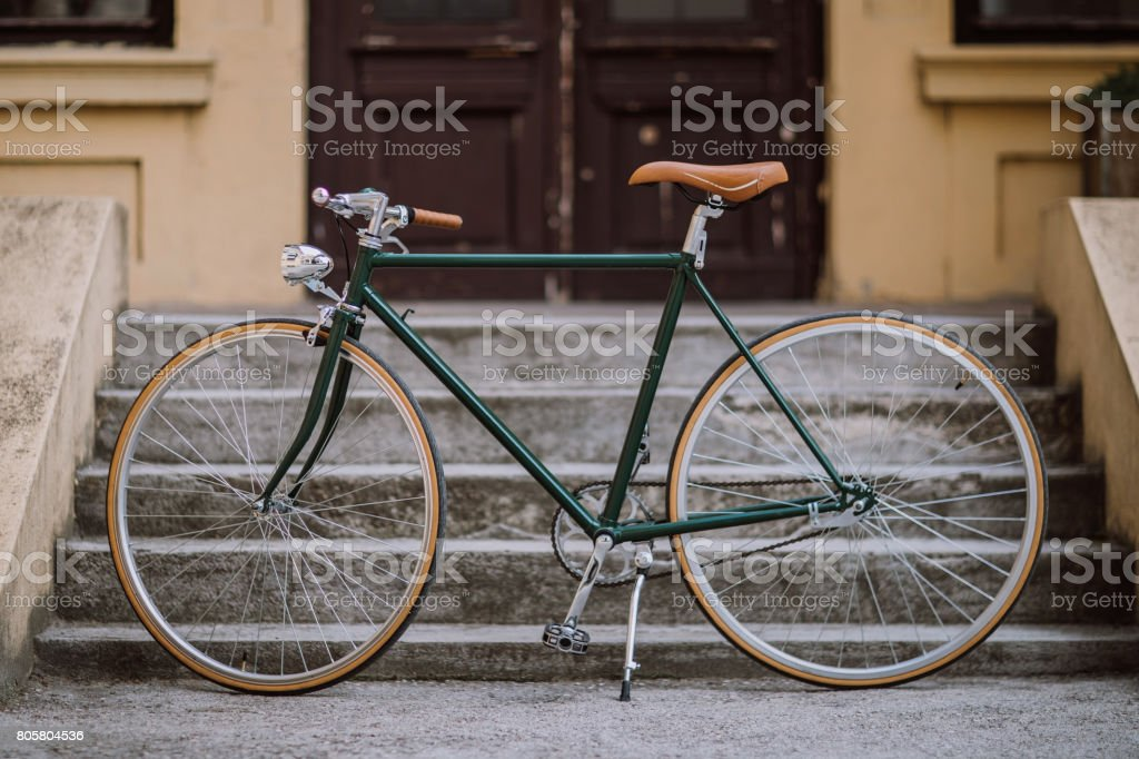 Green old-fashioned bicycle stock photo