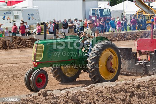 De Pere, WI, USA - August 18, 2012: Green Oliver Tractor competing at the Tractor Pull event at the Brown County Fair.