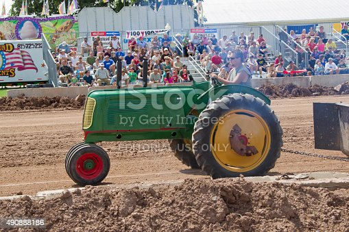 De Pere, WI, USA - August 18, 2012: Side view of Green Oliver Tractor competing at the Tractor Pull event at the Brown County.