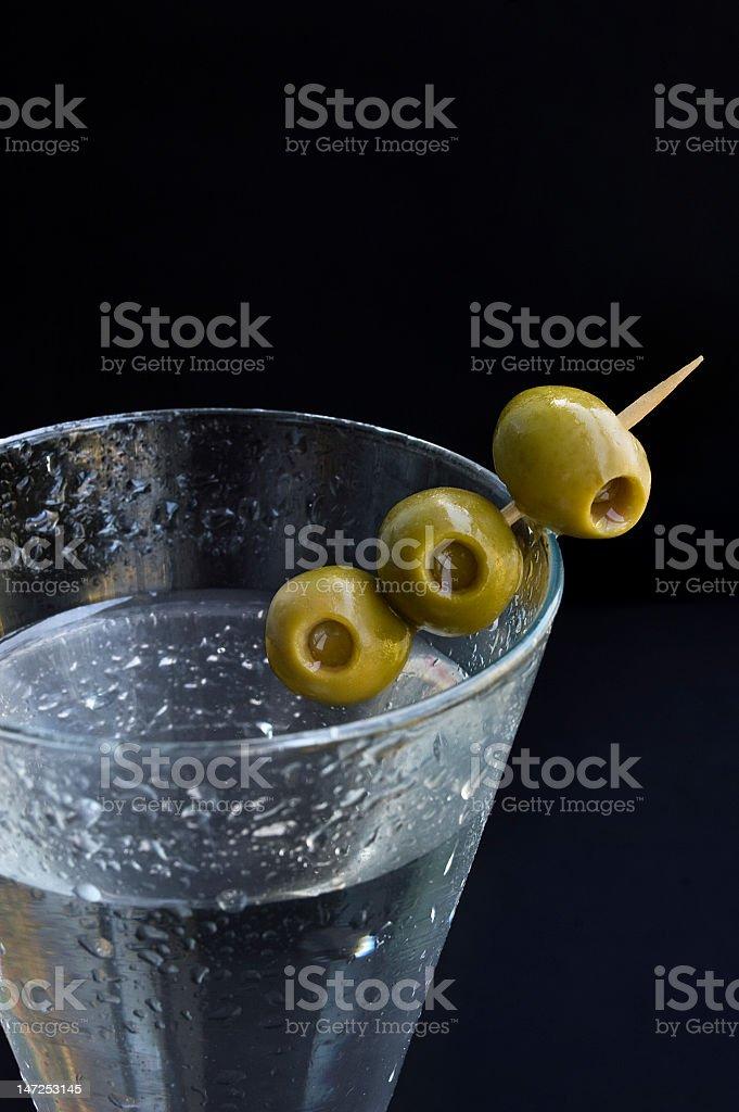 Green Olives Garnishing a Martini royalty-free stock photo