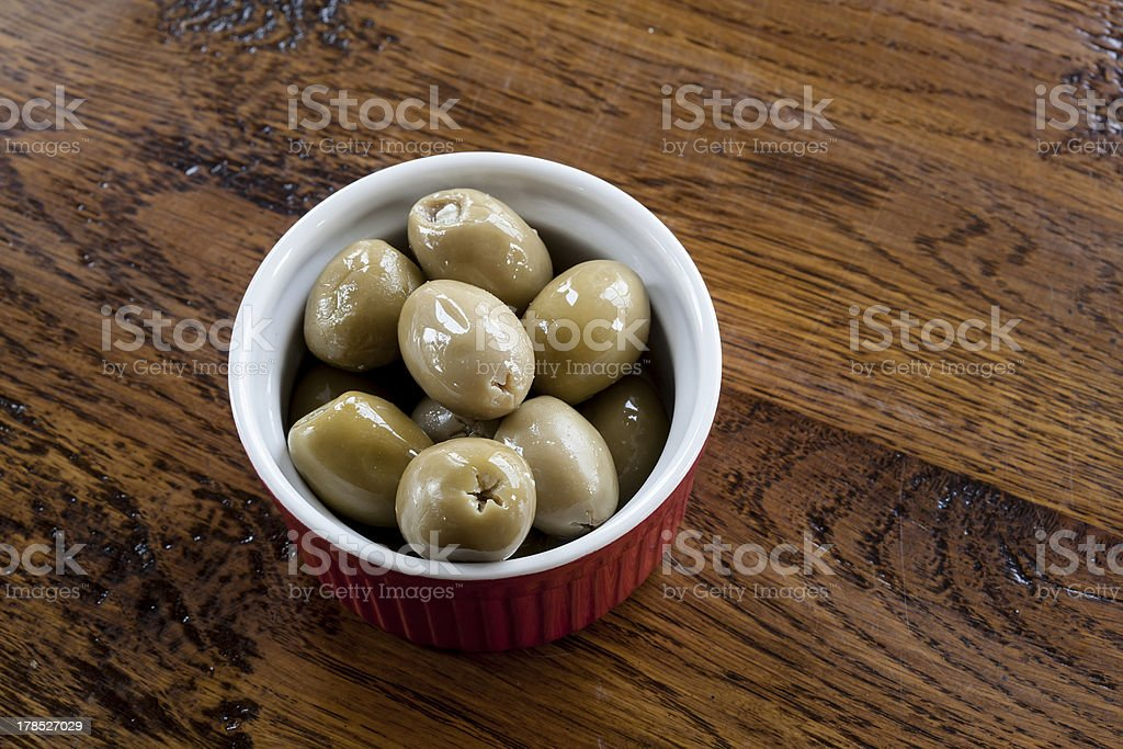 Green Olives in a Red and White Bowl royalty-free stock photo