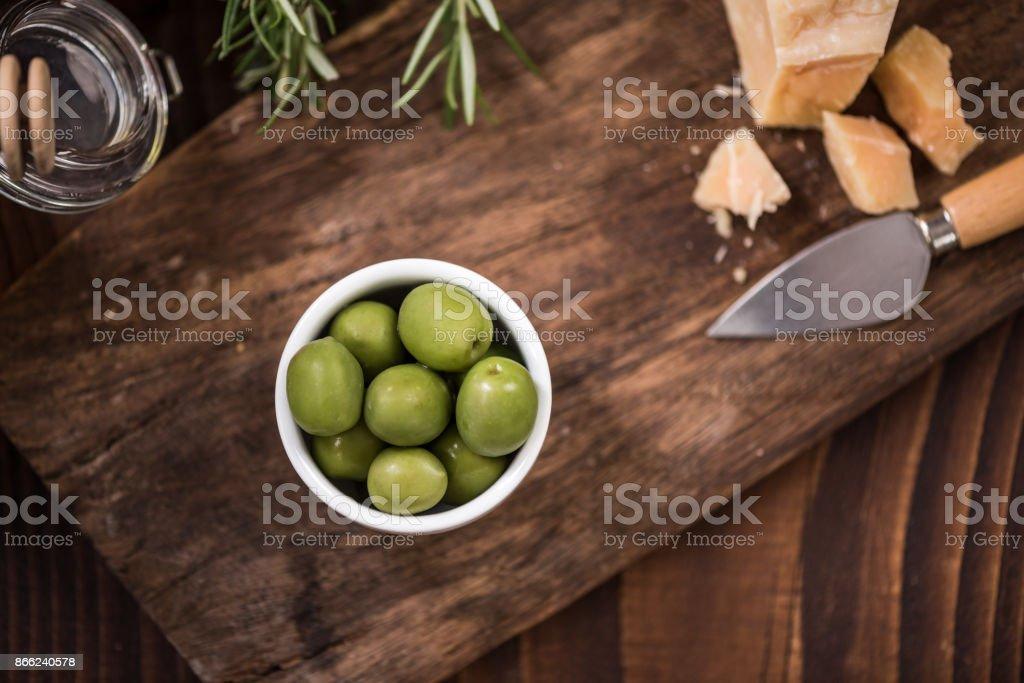 Green olives in bowl,spanish tapa bar food stock photo