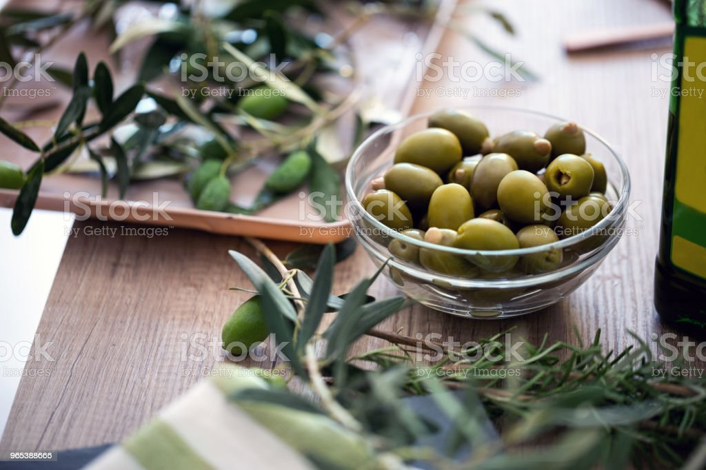 Green olives in the bowl served for snack royalty-free stock photo