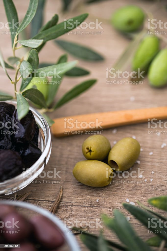 green olives of wooden table background royalty-free stock photo