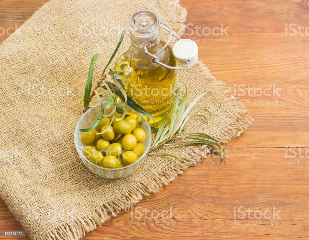 Green olives, olive oil and olive branches stock photo