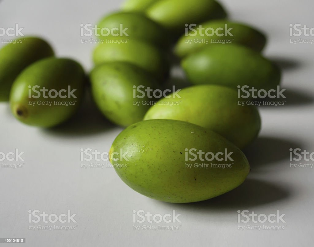 Green olives on a white background stock photo