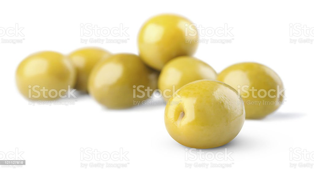 Green olives on white background, selective focus royalty-free stock photo