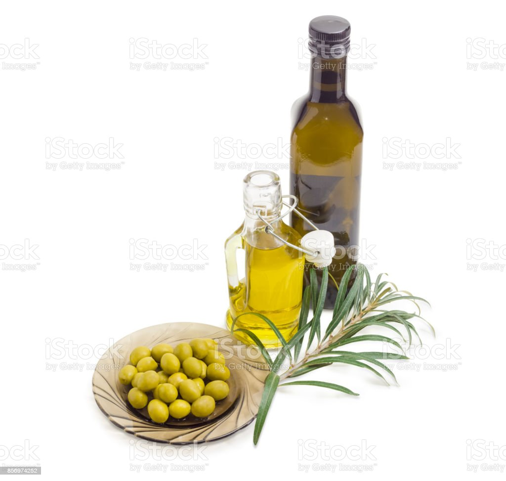 Green olives, two bottles of olive oil and olive branch stock photo