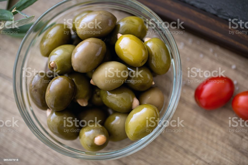 Green olives with almond in the bowl served for snack zbiór zdjęć royalty-free