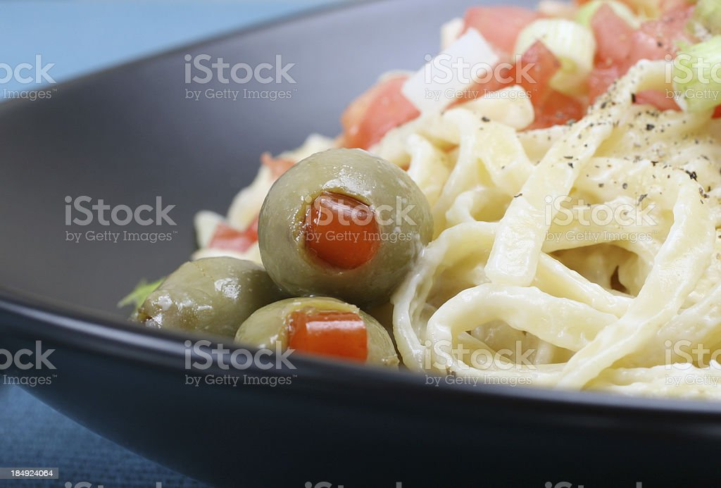Green Olives with Fetticini royalty-free stock photo