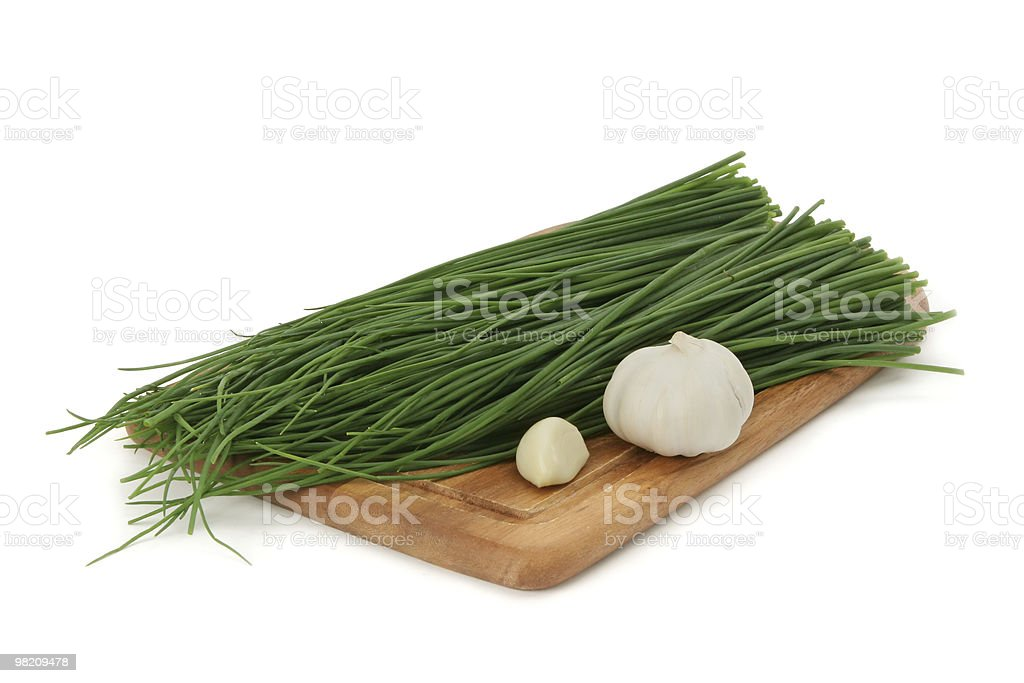 green onion and garlic on a board royalty-free stock photo