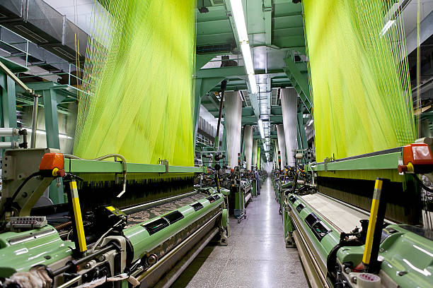 Green operating machines at a textile factory stock photo