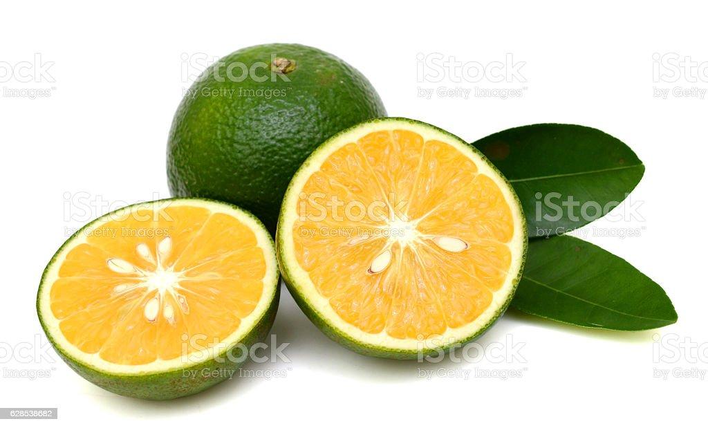 green orange fruit on white stock photo